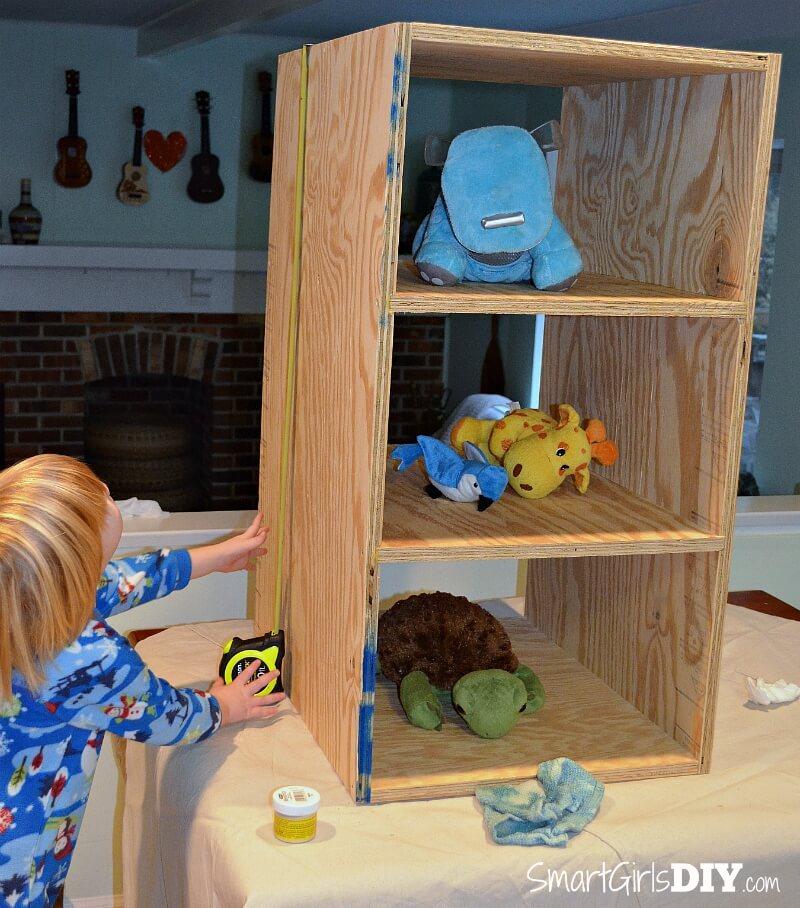 My son helping me build a laundry basket shelf
