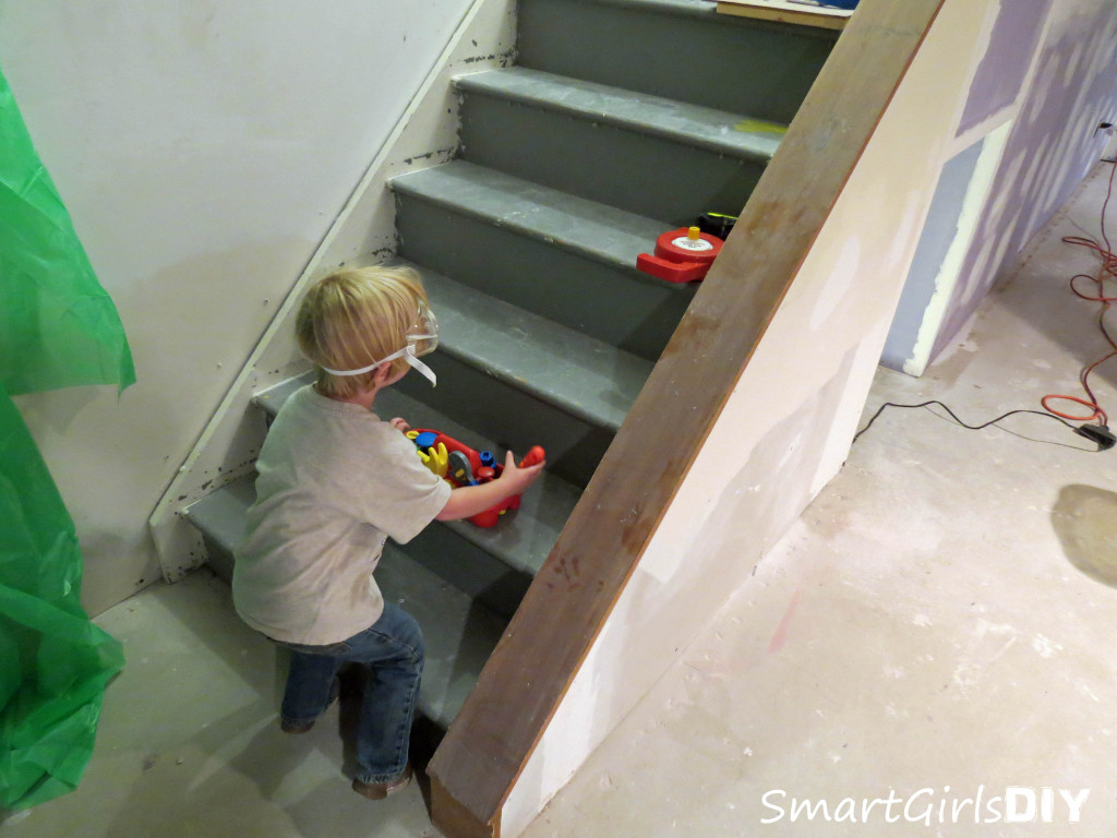 My cute 3-year-old helping renovate the basement stairs