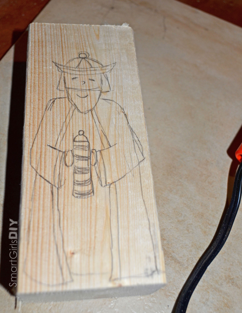 Drawing Wise Man on Wood Block
