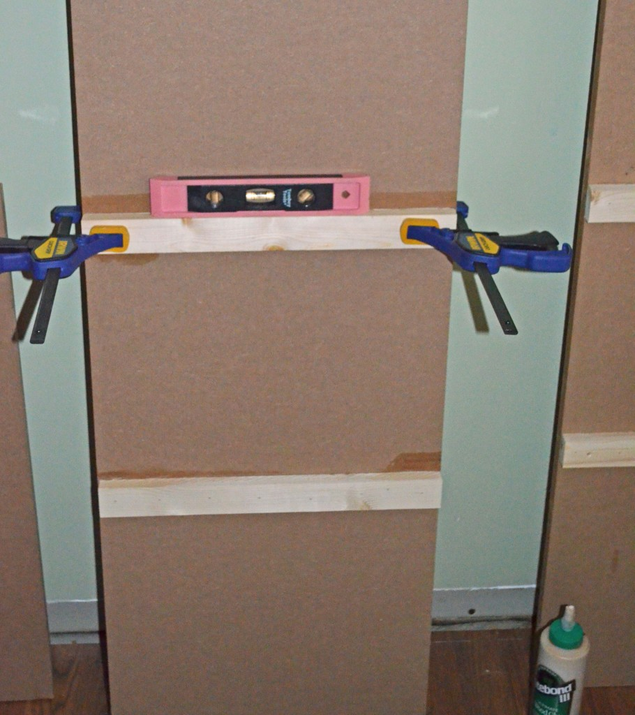 Gluing and nailing shelf supports