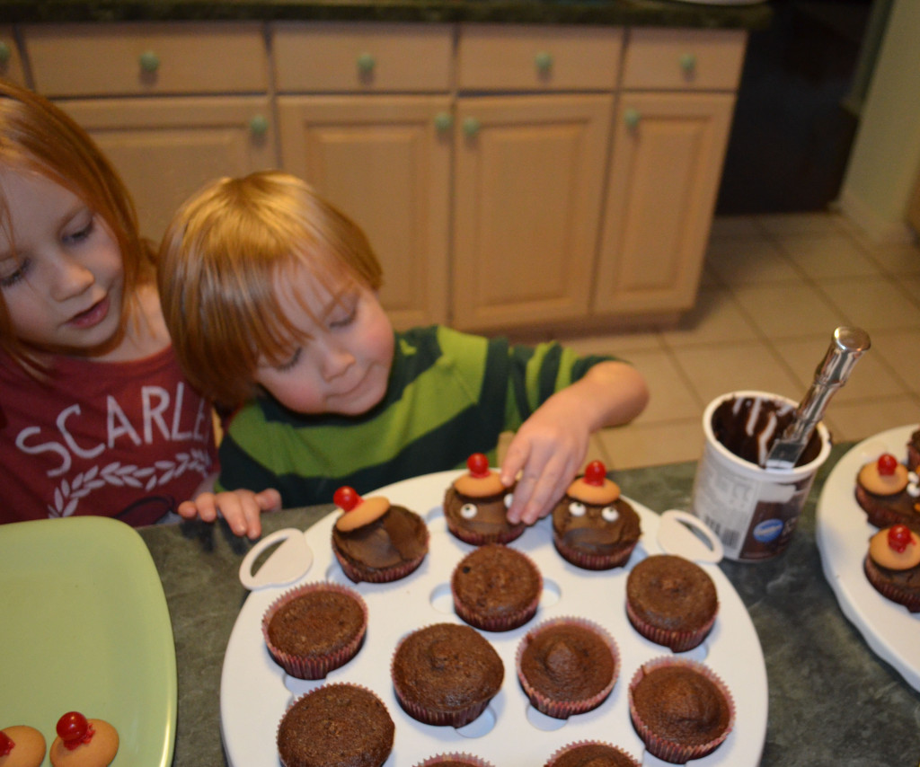 Putting googly eyes on cupcakes