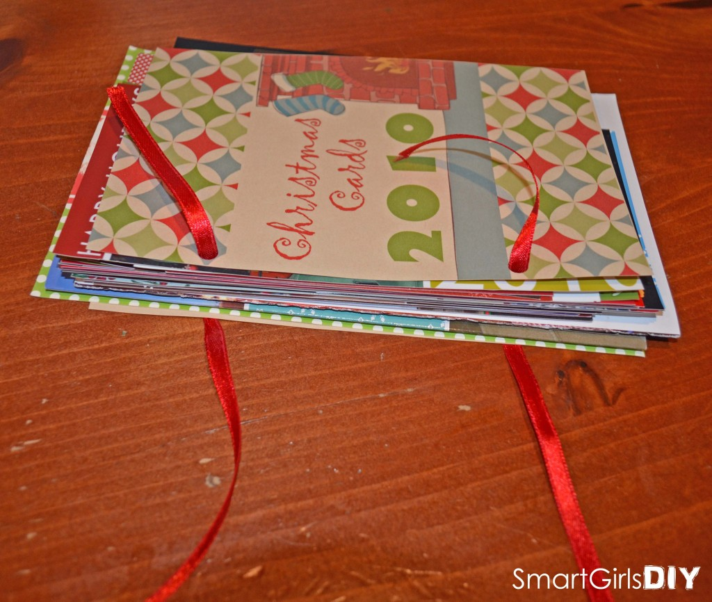 Adding ribbon to Christmas card storage book