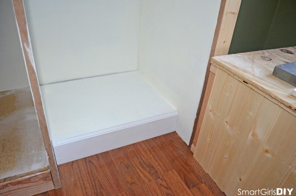 Adding trim to bottom shelf of built-in