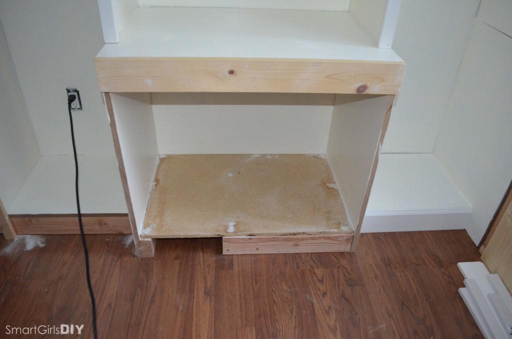 Bottom shelf of wall unit