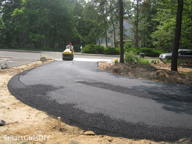 Smoothing out asphalt after its poured