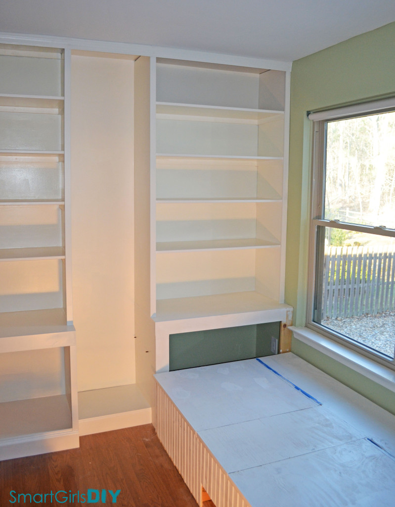 Window seat day bed and built-in bookshelves