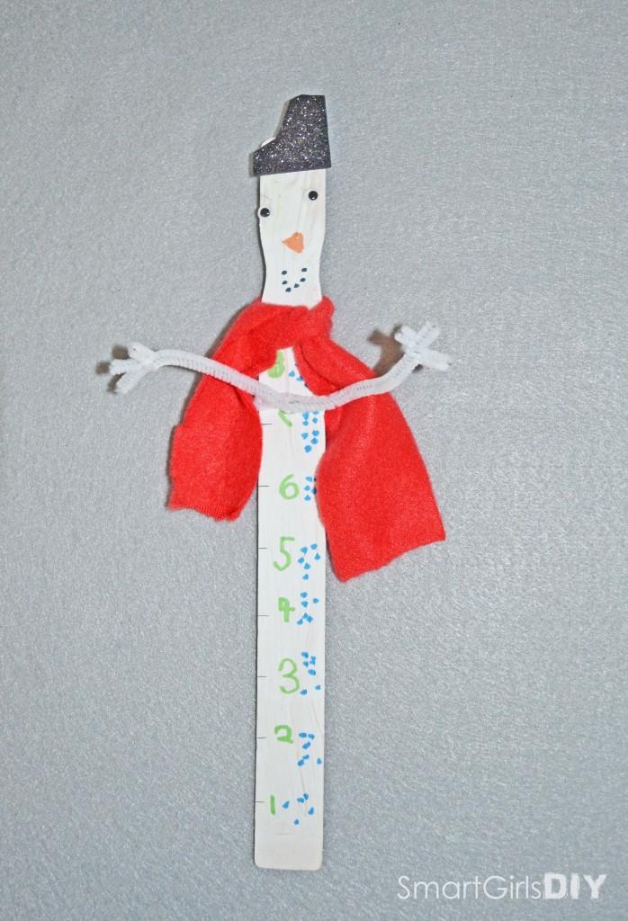 Paint stirrer snowman measuring stick