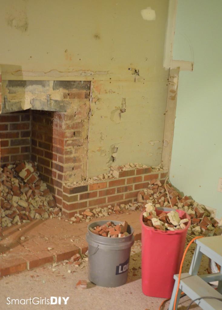Brick fireplace wall demolition
