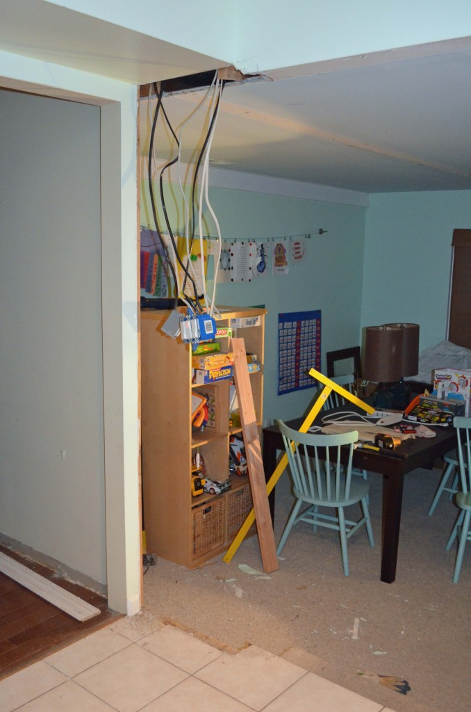 Electrical wires hanging from ceiling after wall removed