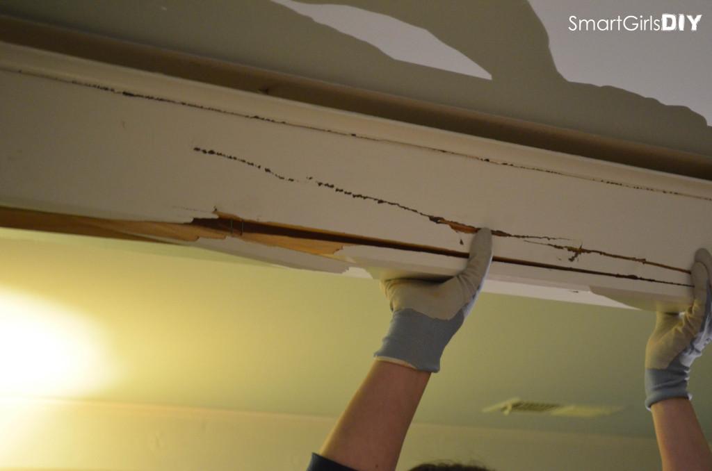 Team effort to get ceiling beams down