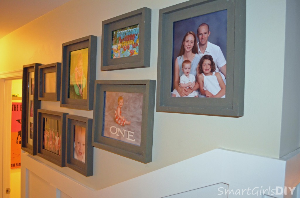 One wall of pictures up above board and batten in hallway