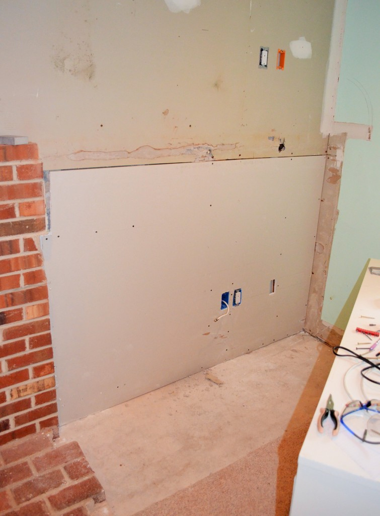 Area next to fireplace finally drywalled still needs mud