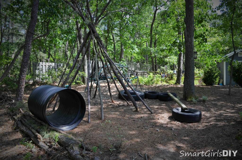 Backyard fun - teepee, tires, pipe to crawl through