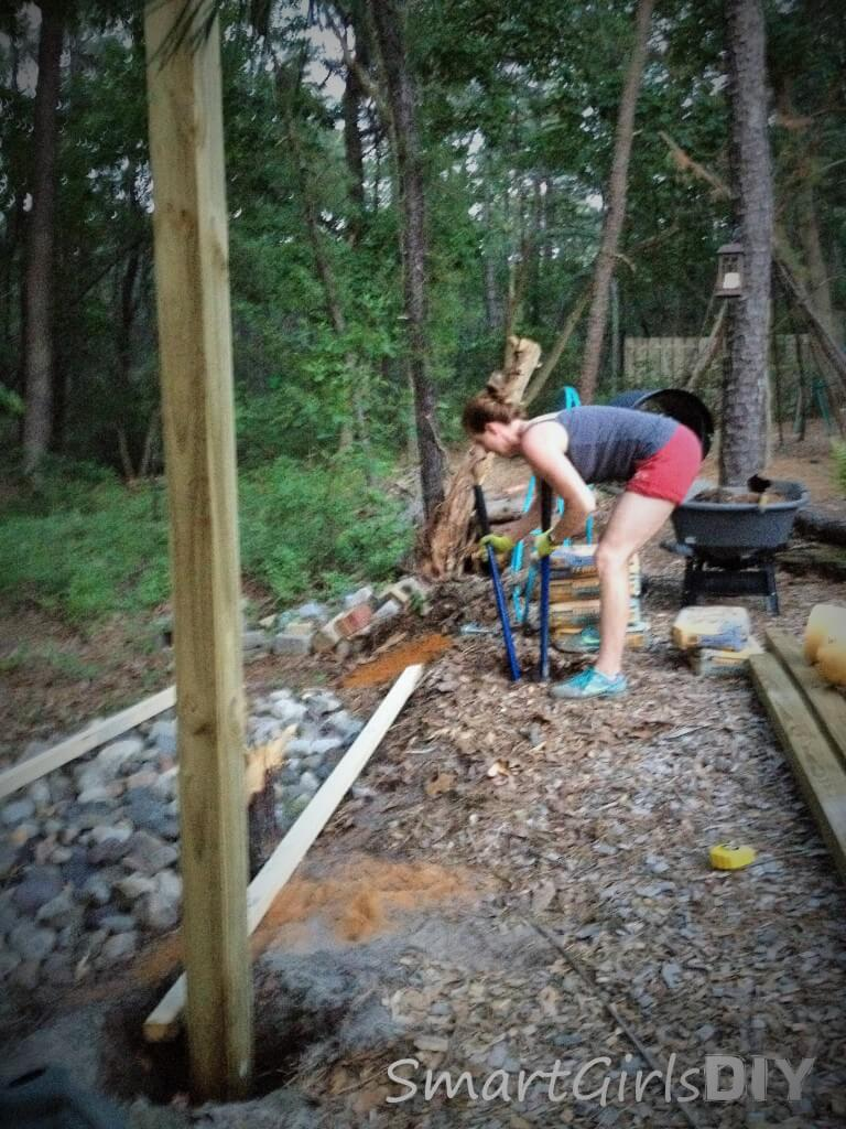 Digging a post hole with clam digger - building an outroor shower