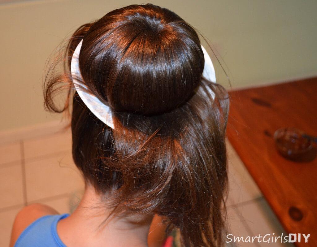 Tuck tthe ends of hair under the bun