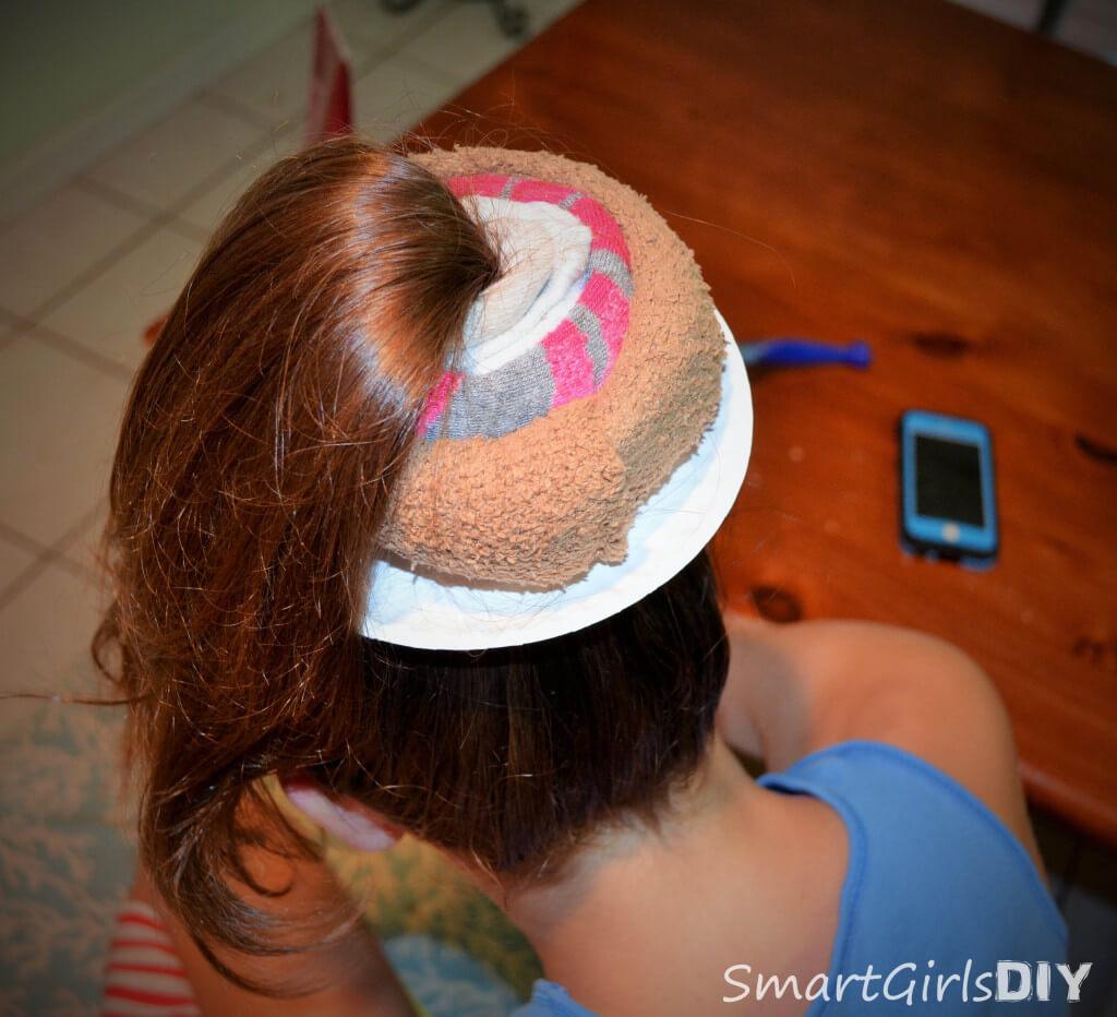 Wrap sock around ponytail to make sock bun