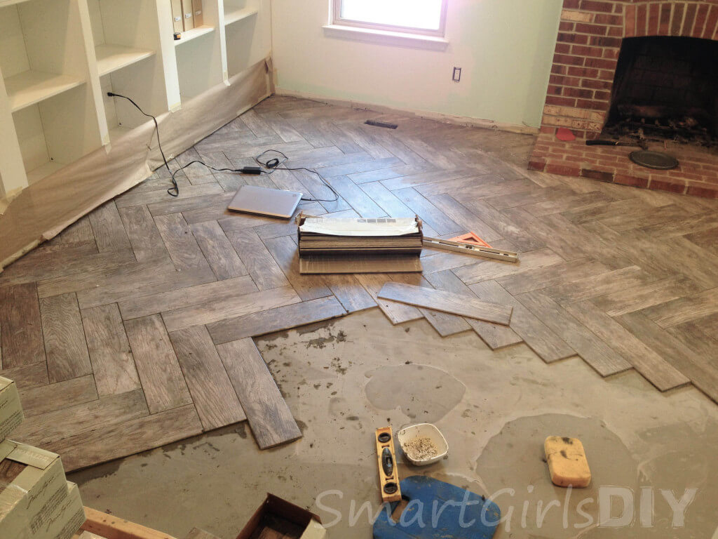 Day 4 of tiling the family room in a herringbone pattern