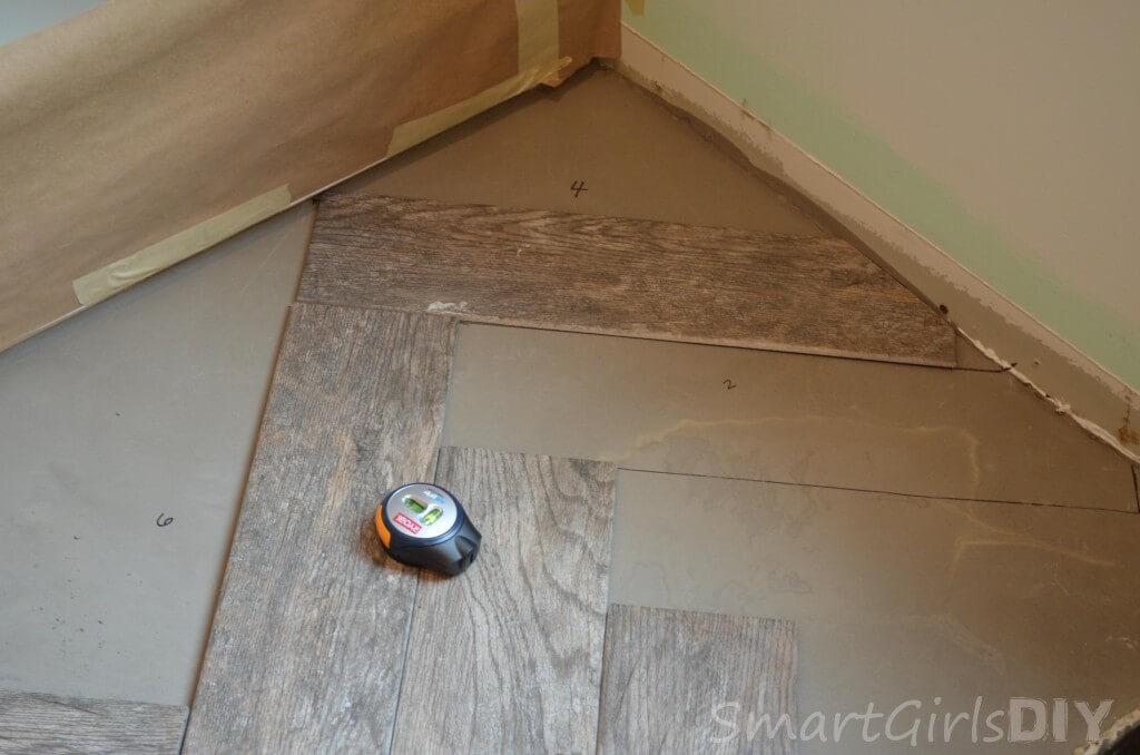 Idea of what herringbone floor pattern looks like to cut in corners