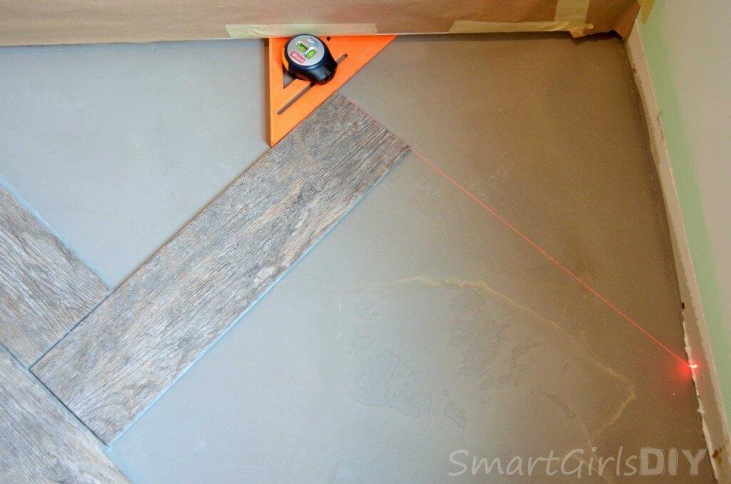 Marking out herringbone pattern in corner is the trickiest