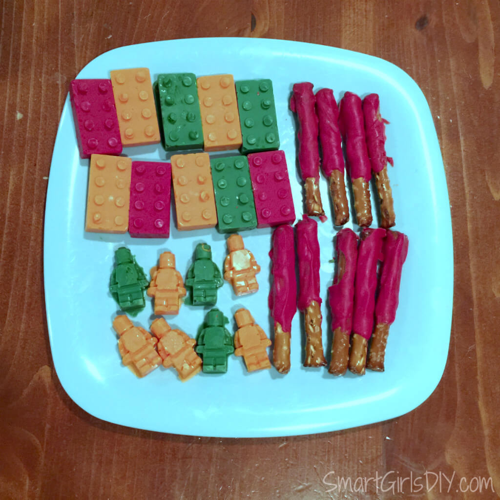 Lego mold chocolates and light saber pretzels