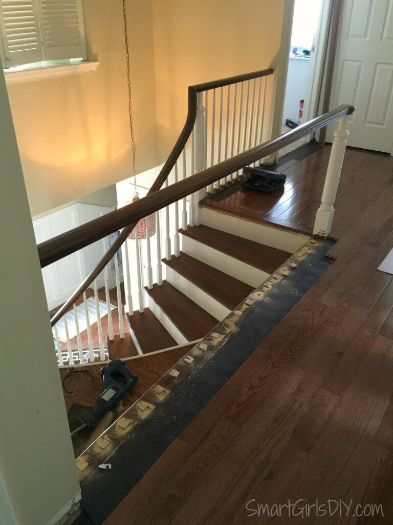 DIY hardwood floor in hallway overlooking staircase
