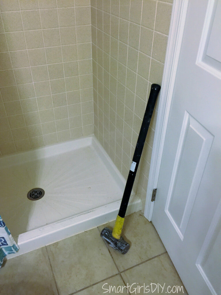 Demolishing a dated shower pan with my trusty sledgehammer