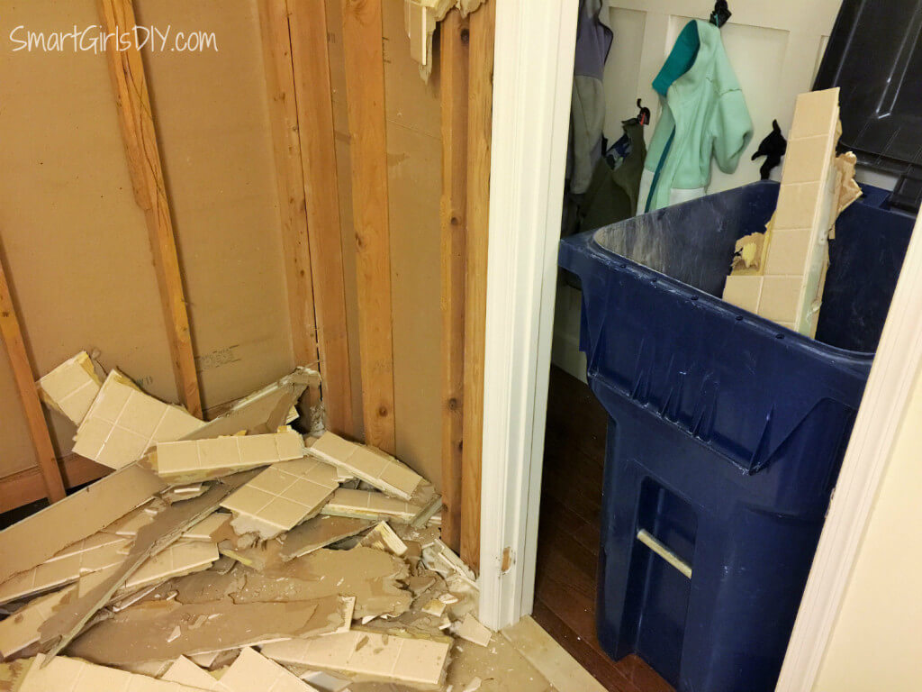Trying to fit tile from bathroom demo into township garbage can