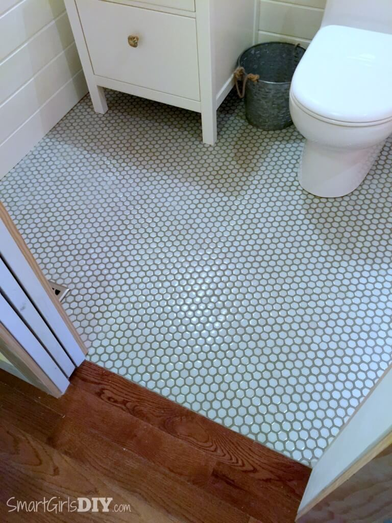 Bathroom makeover - hexagon floor tiles with painted grout lines transition to hardwood floor