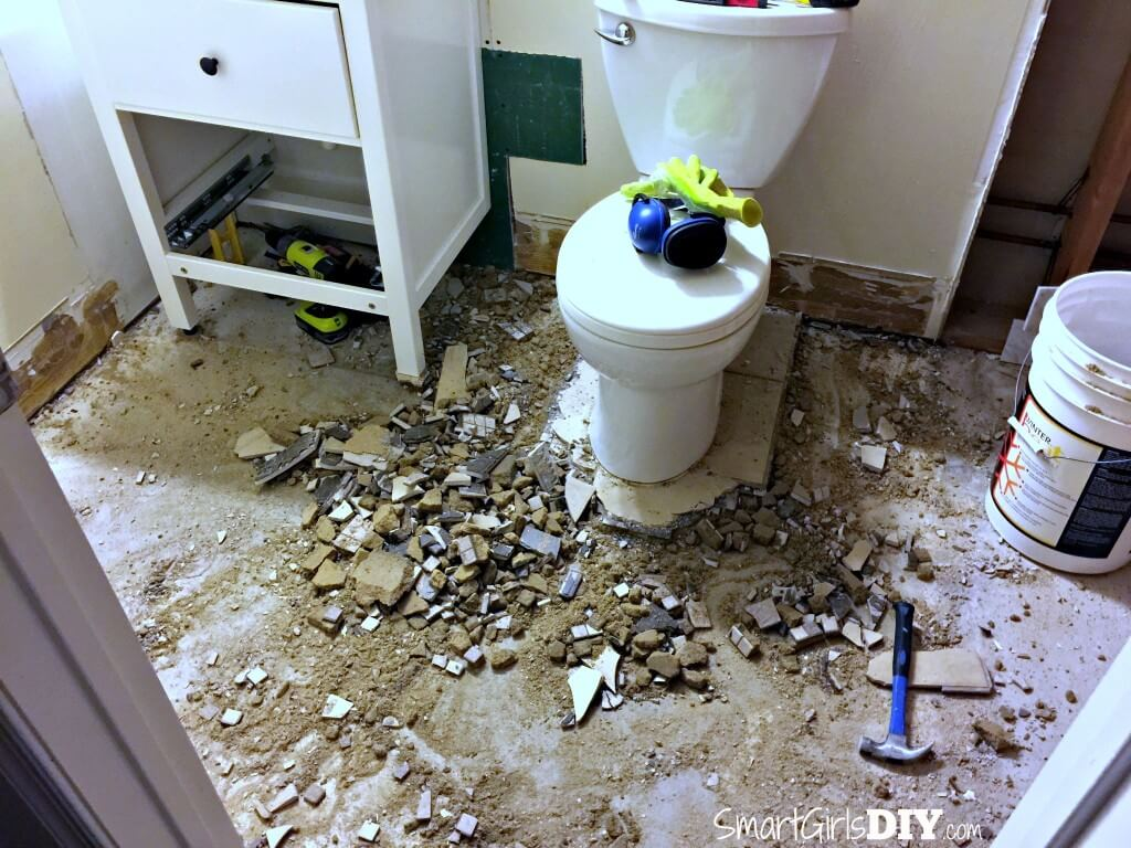 Demo tile bathroom floor - still using toiled and sink