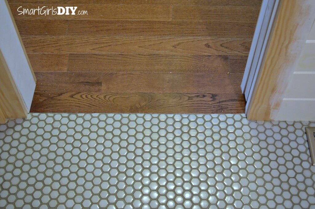 Smooth transition between mosaic floor tile and hard wood flooring