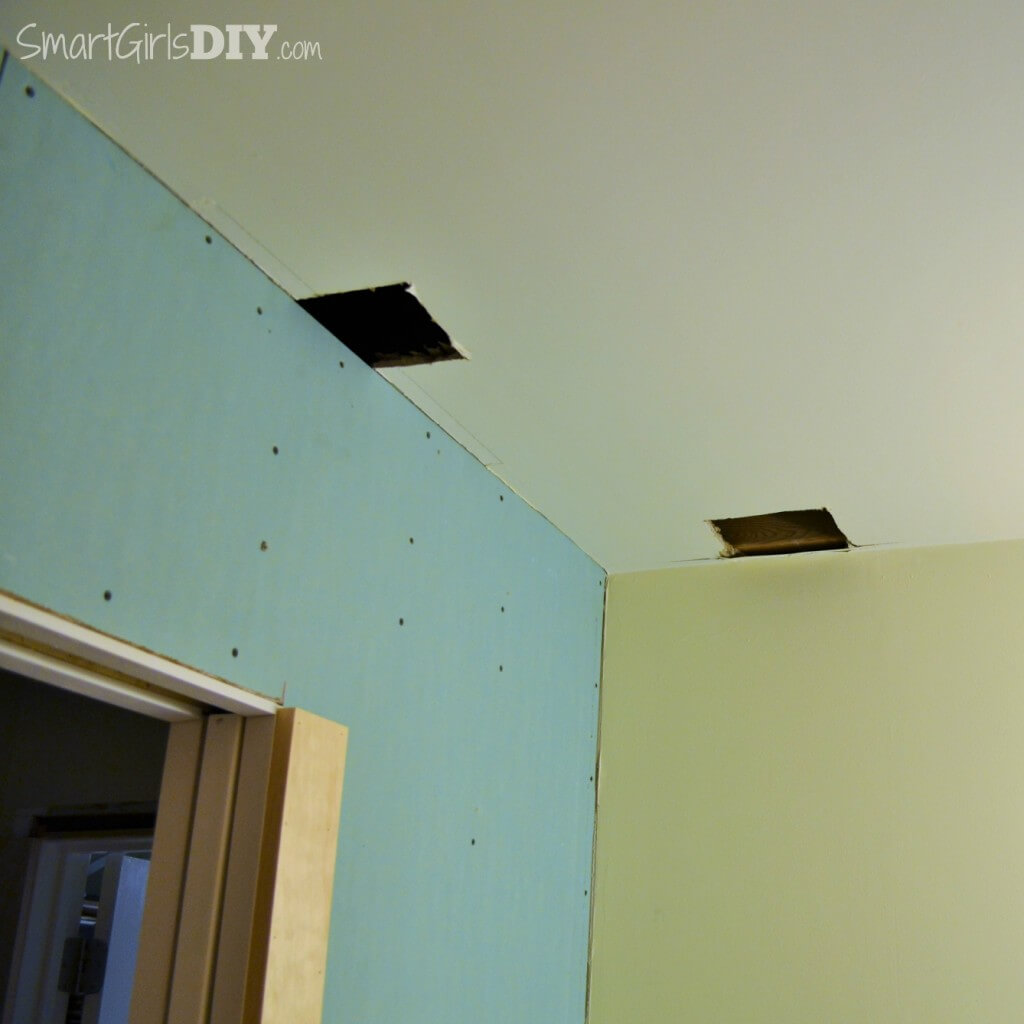 Two holes cut in drywall