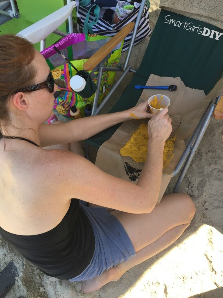 Crafting on the run -- painting a banner while hanging with friends at the lake