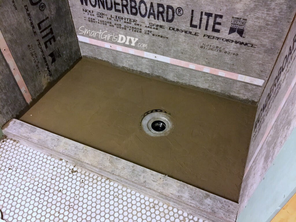 How to build a shower floor otu of dry pack mortar - almost finished here