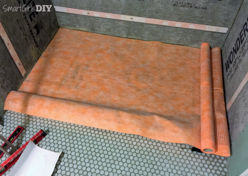 Measure and cut Schluter Kerdi to fit the shower pan