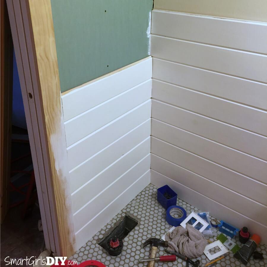 Pocket door wall gets wood planking