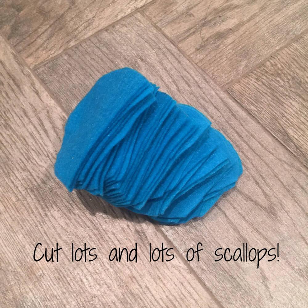 Cut lots of felt scallops