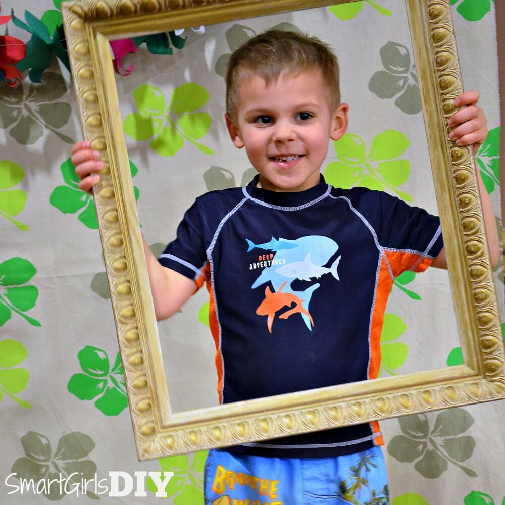 Use an empty frame as a photo booth prop -- Easy and cheap!
