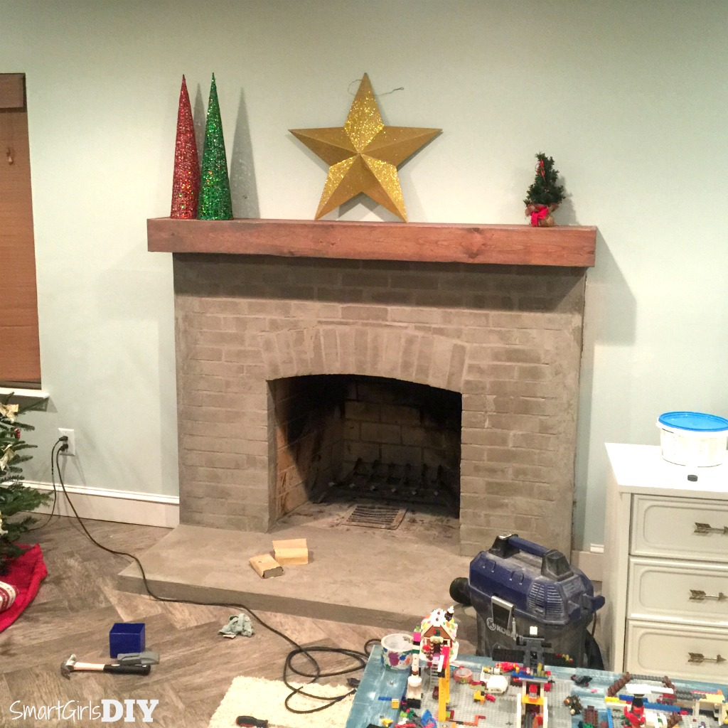 Ardex Feather Finish over brick fireplace