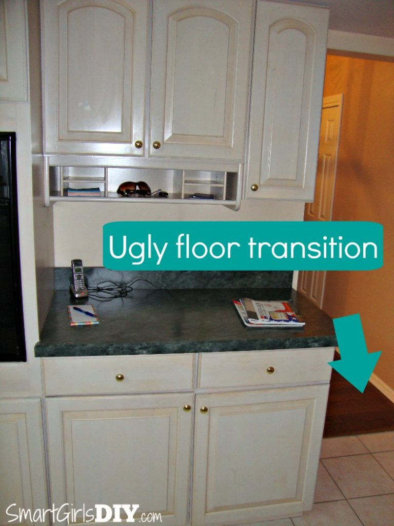 Before - Ugly floor transition into kitchen