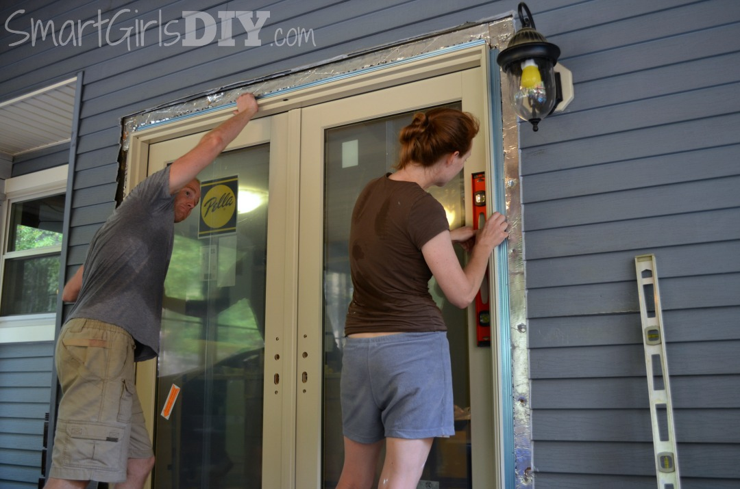 Checking for level on DIY Pella Patio door install