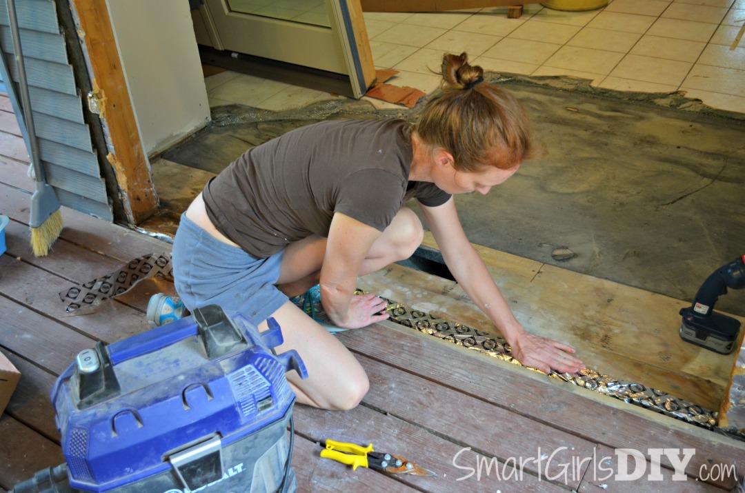 DIY Patio door install - first apply the Pella tape to the door frame