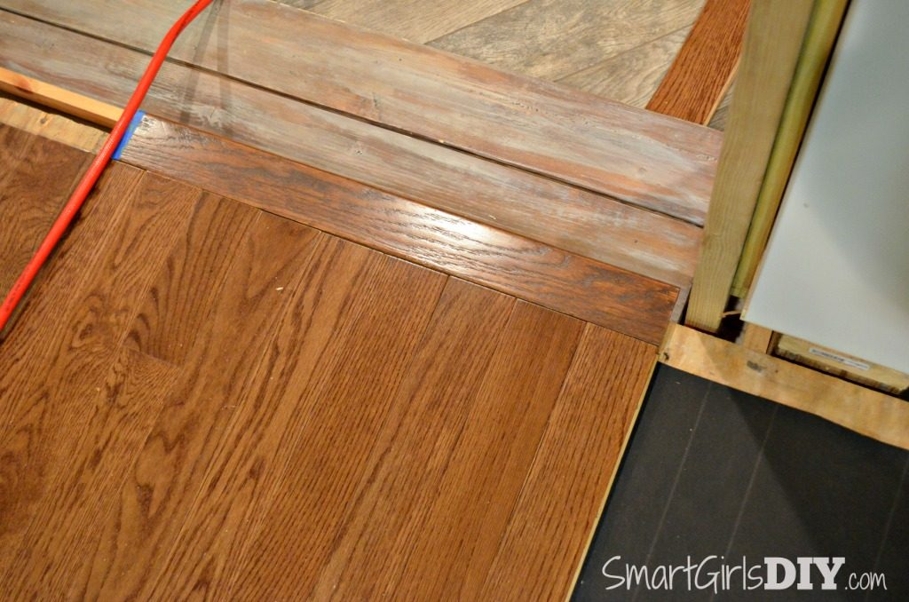 Hardwood floor installed with bullnose edge over step