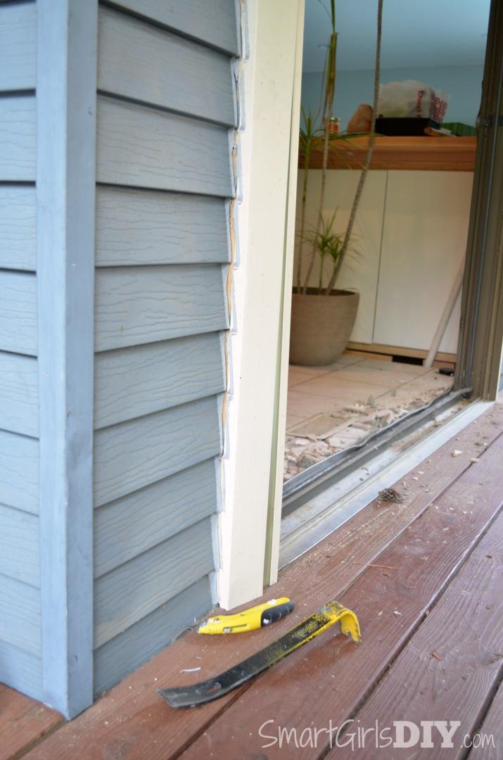 Use a sharp blade to cut the caulk around the trim molding