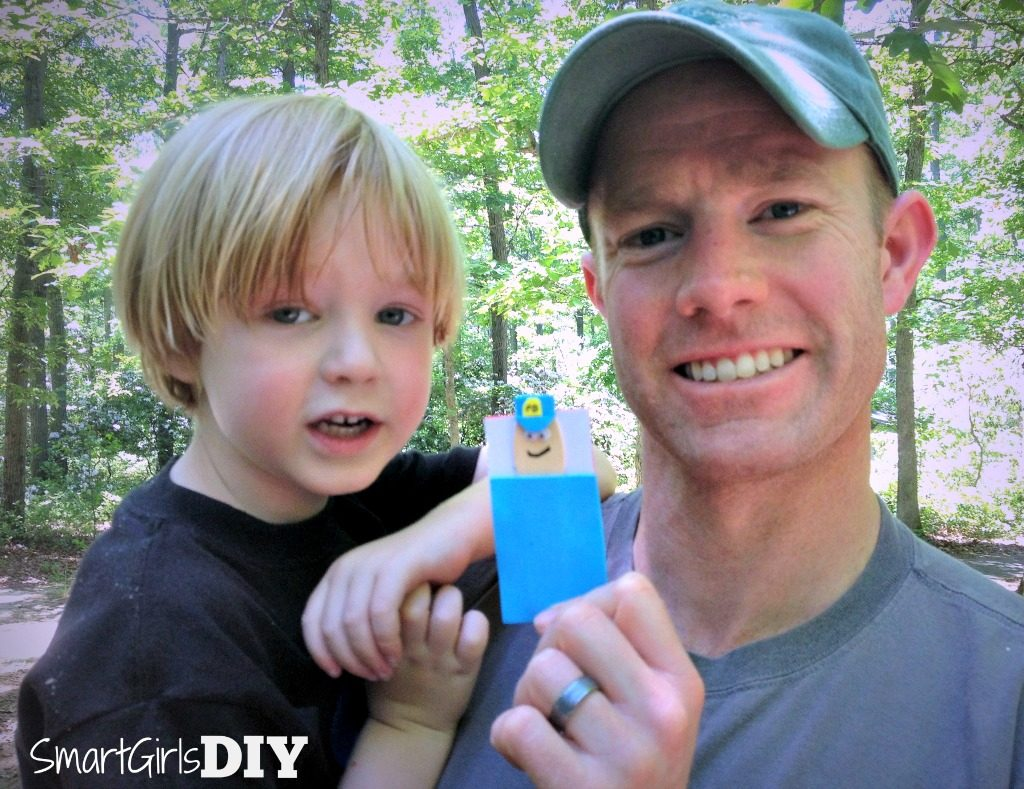 daddy-and-son-making-crafts-at-camp-police-man-in-sleeping-bag-swap